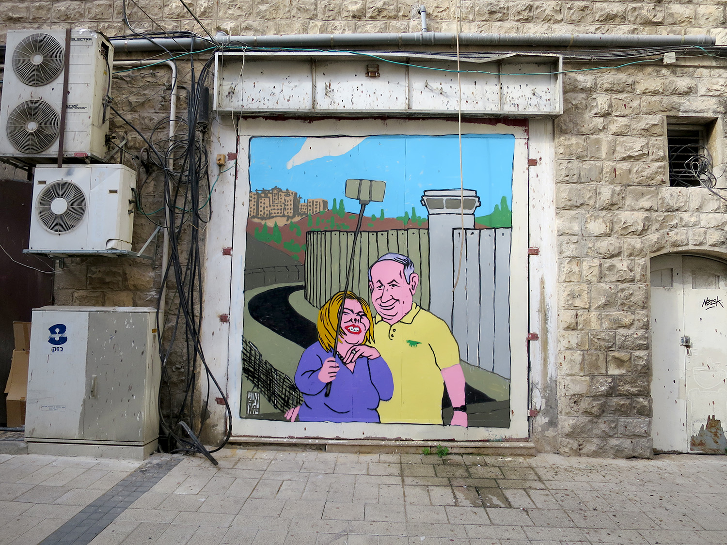 broken fingaz unga graffiti israel gaza occupation peace separation wall  selfie stick haifa  street art